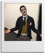 Staff member dressed as Charlie Chaplin for Halloween