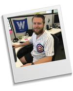 Staff member at desk in Cubs gear